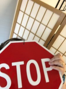 image of a woman pretending to be a stopsign